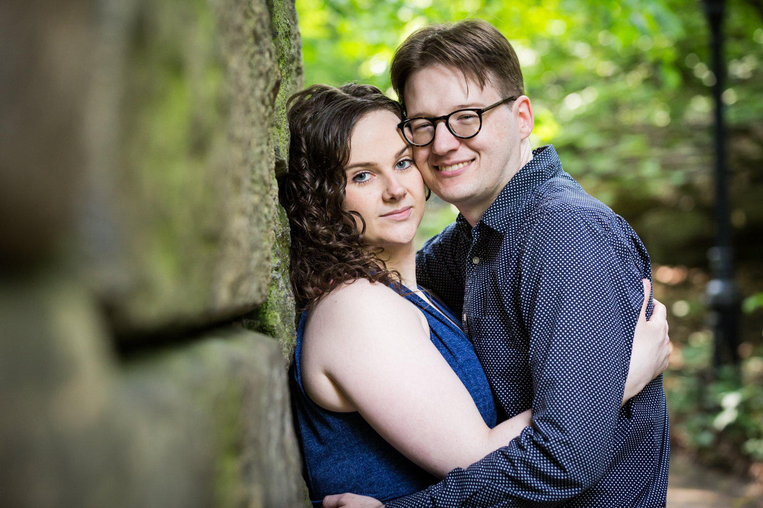 Couple underneath the Ramble Stone Arch in Shakespeare Garden engagement photos