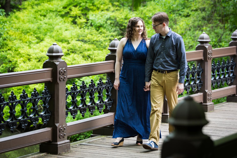 Couple walking on Oak Bridge in Central Park