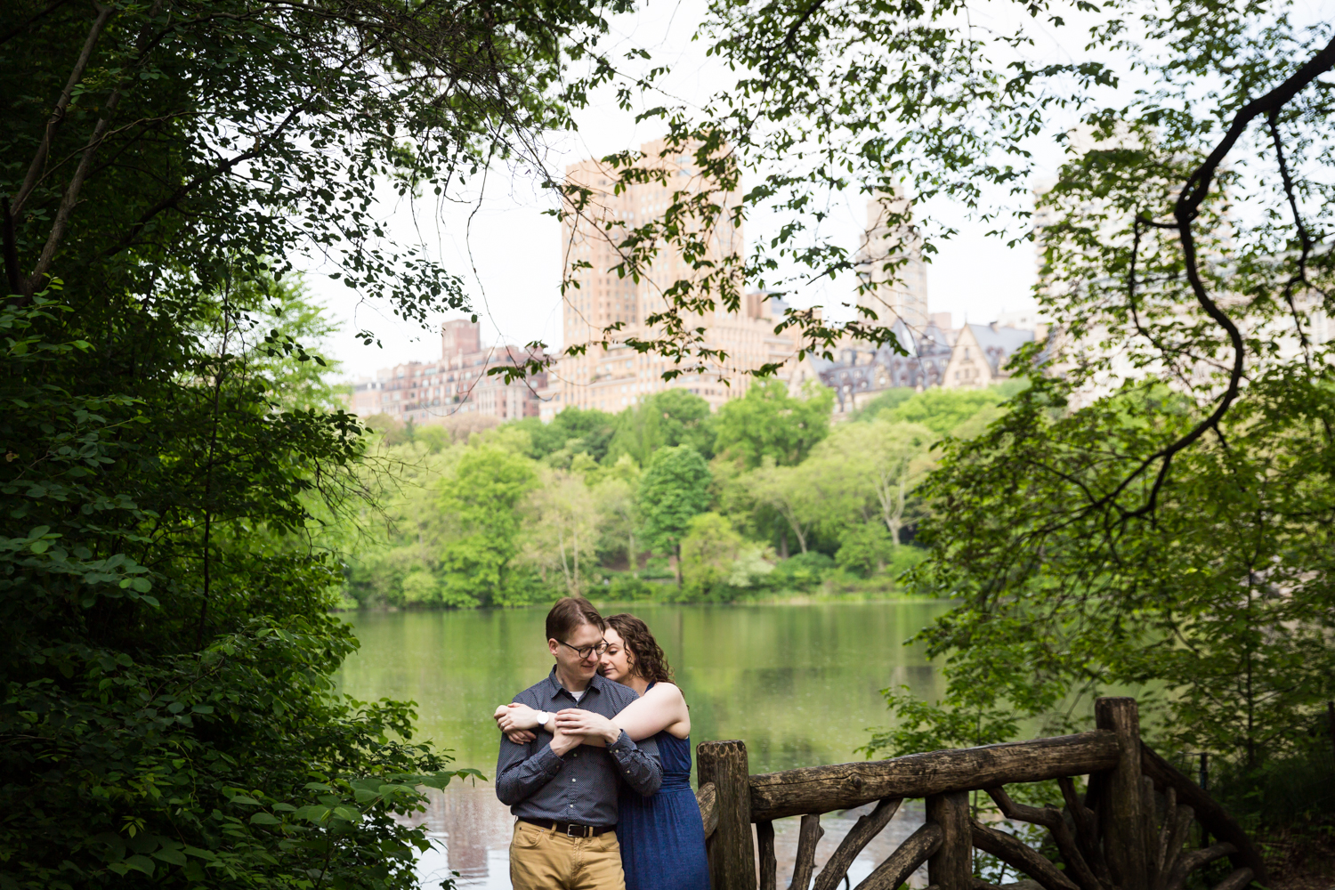 Couple hugging with Central Park lake in background