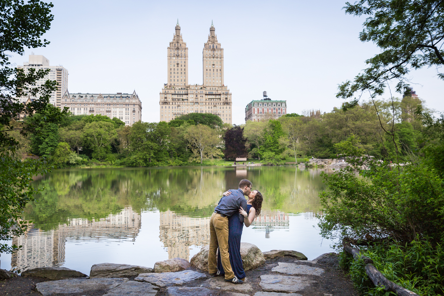 Couple dancing in Central Park lake viewing area