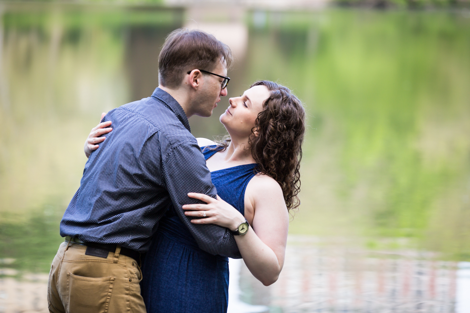 Couple dancing close in front of Central Park Lake