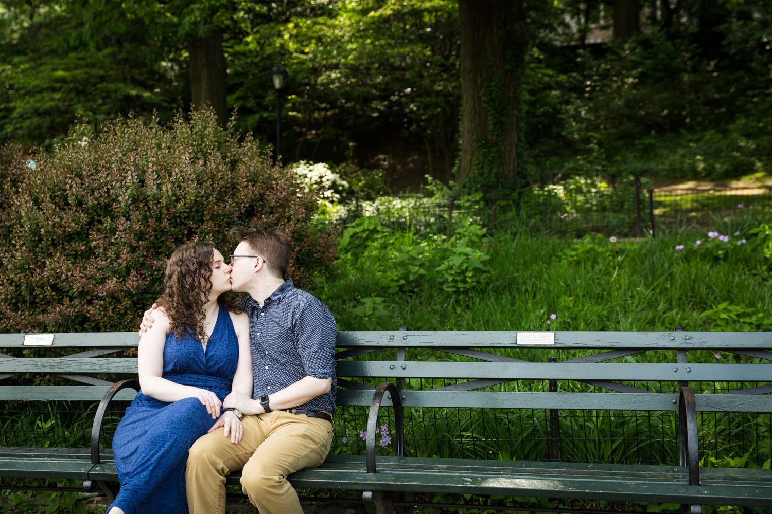 Couple kissing on Central Park bench