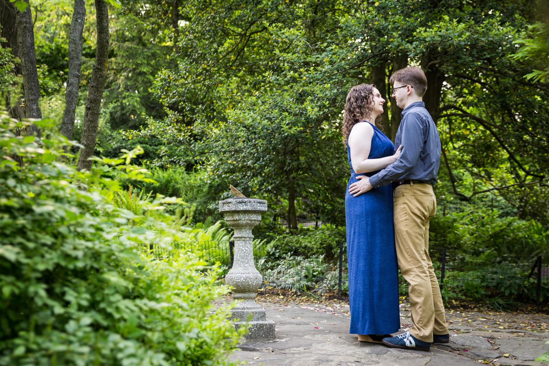 Couple recreating proposal in Shakespeare Garden engagement photos