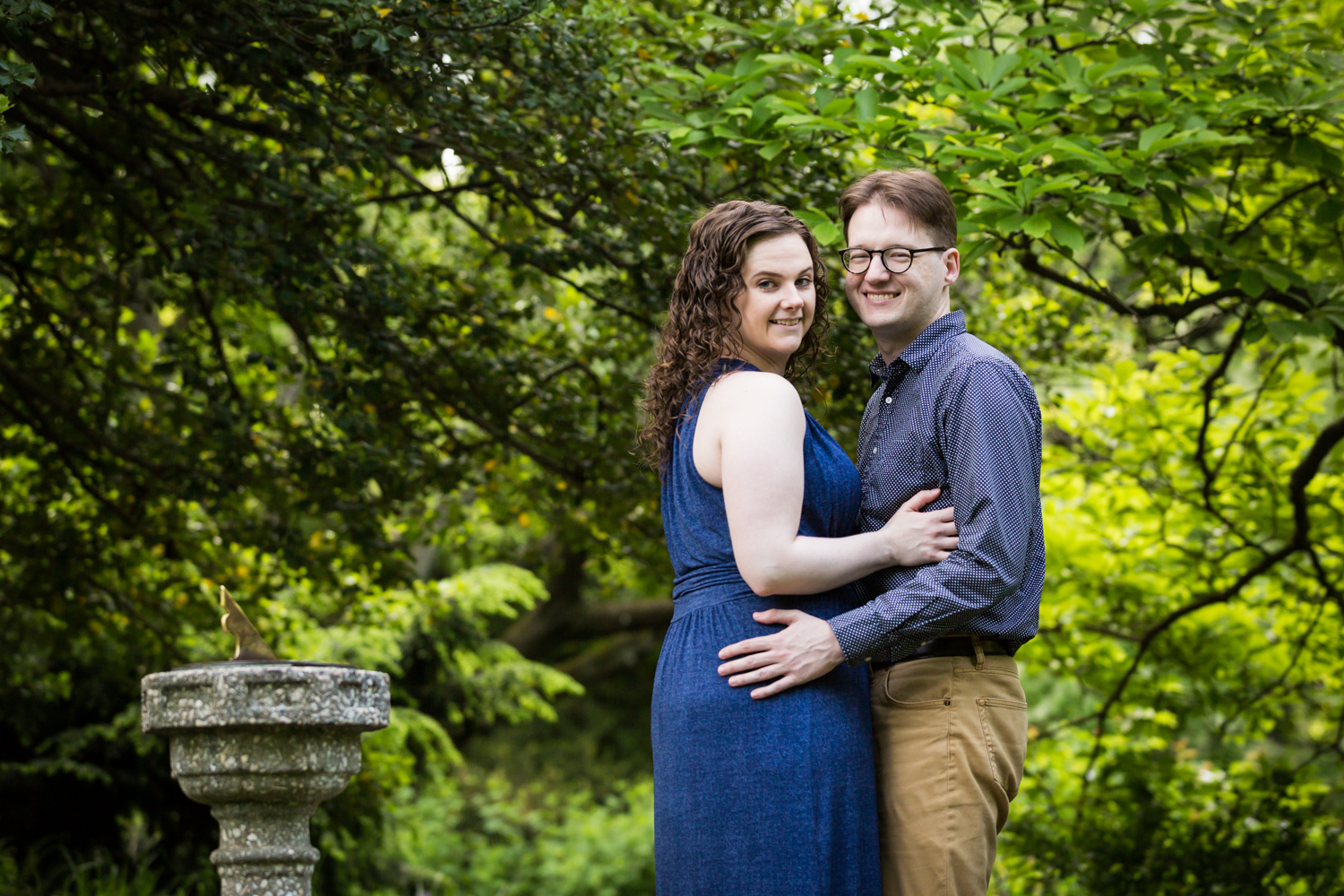 Couple posing in Shakespeare Garden engagement photos