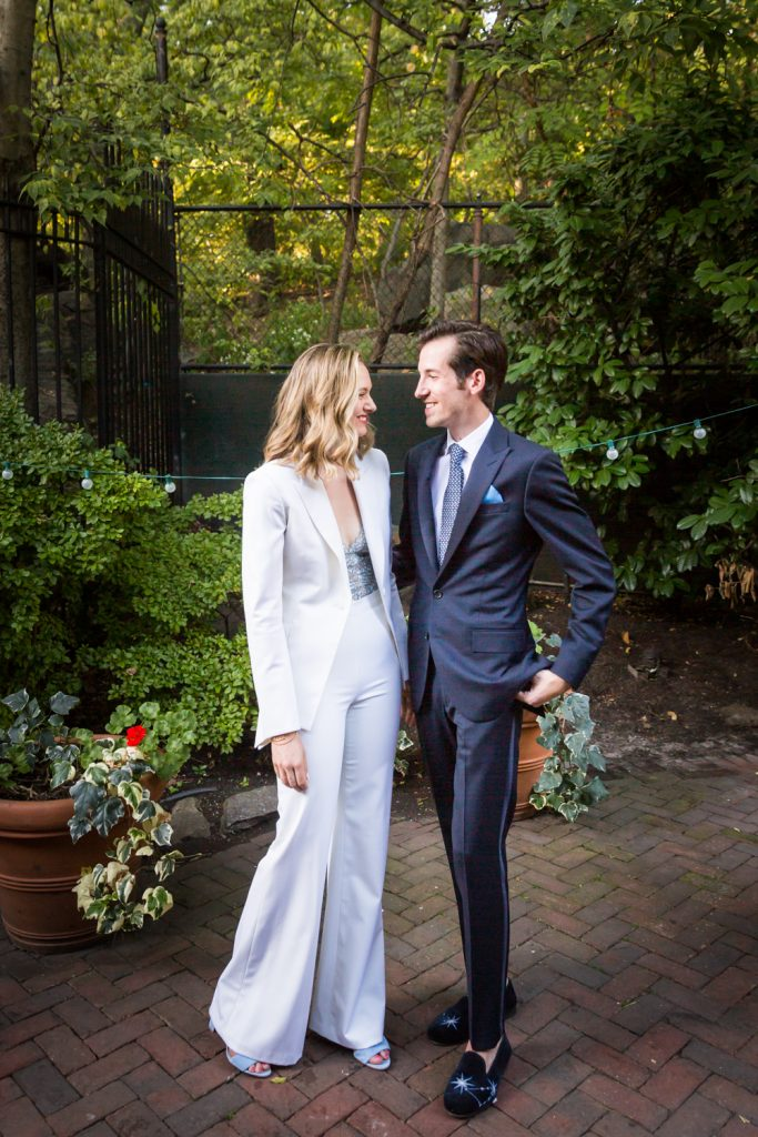 Portrait of Bride in white pantsuit and groom in suit for an article on how to modernize your wedding