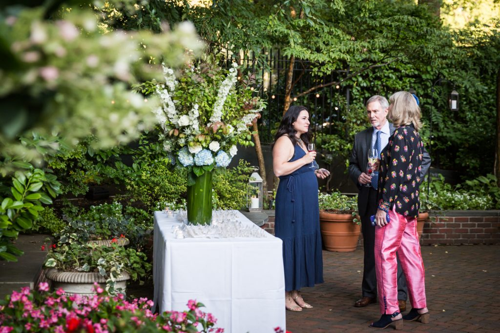 Guests in outdoor patio for an article on how to modernize your wedding
