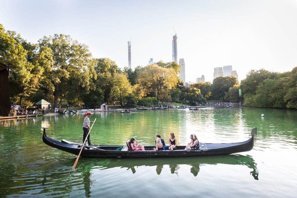 Gondola boat ferrying people in Central Park lake