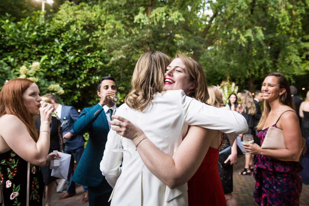 Guest hugging bride at Central Park wedding cocktail party
