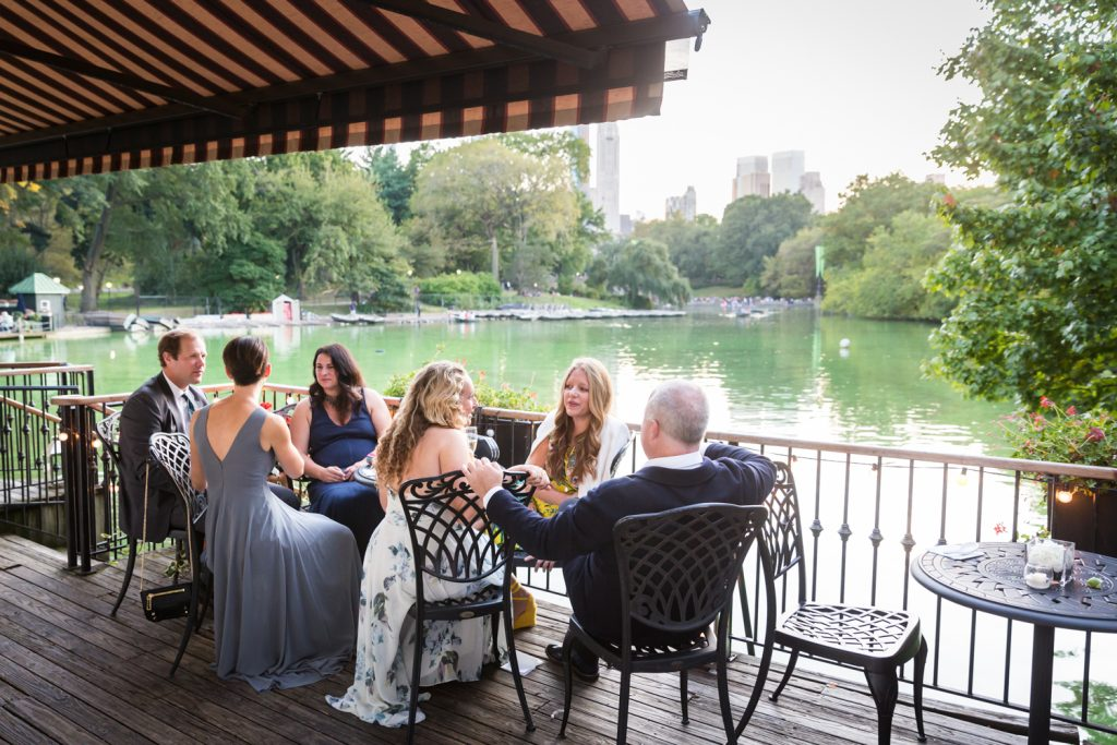 Guests on the patio of the Central Park Boathouse at a wedding cocktail party