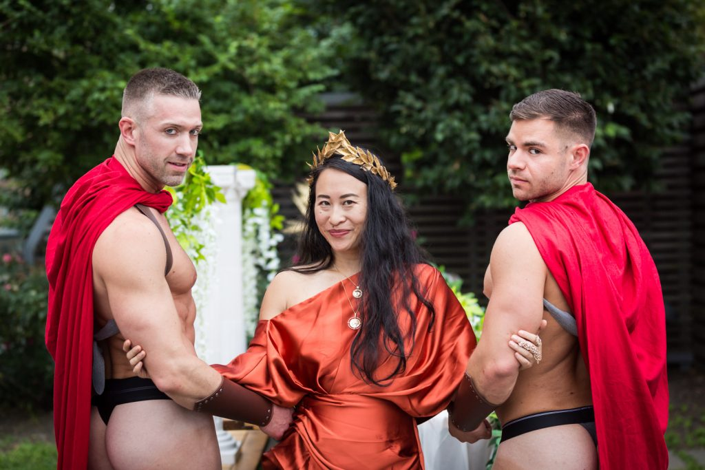 Birthday party photography of woman and two men dressed in Roman costumes