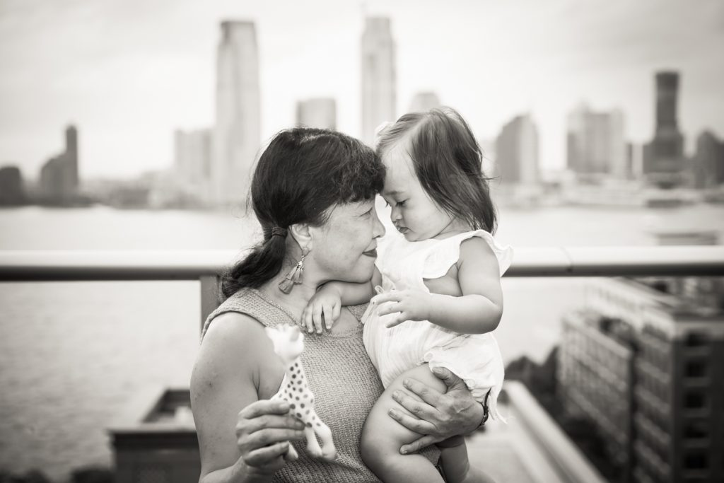 Black and white photo of grandmother holding little girl