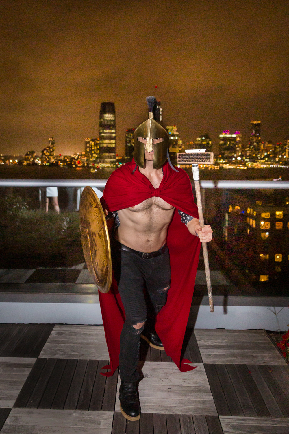 Birthday party photography of guest dressed in gladiator uniform and helmet