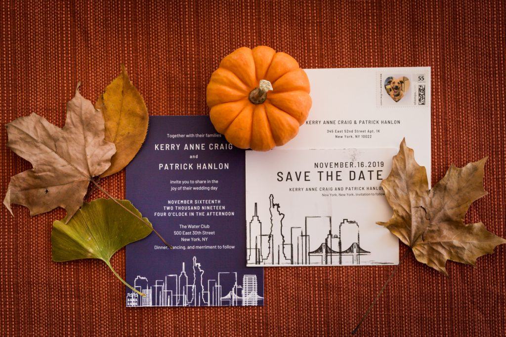 Wedding invitations surrounded by a pumpkin and leaves