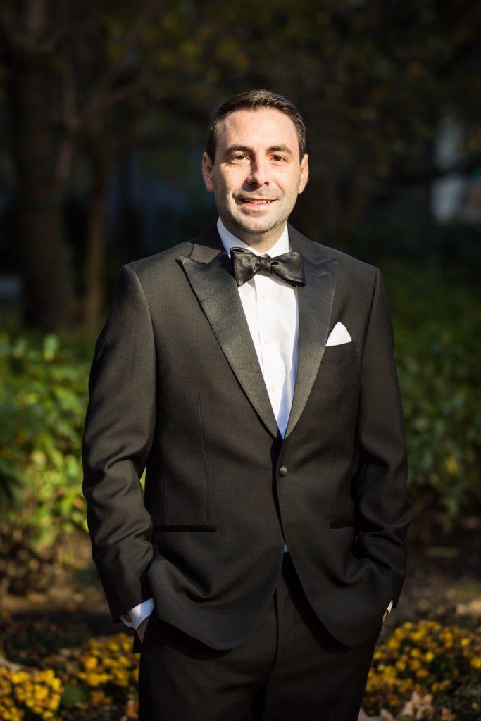 Portrait of groom wearing tuxedo at a Water Club wedding