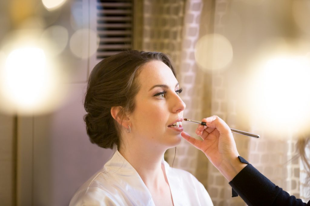 Bride having lipstick applied at a Water Club wedding