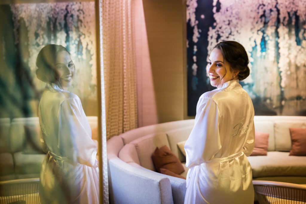 Reflection of bride in white robe at a Water Club wedding