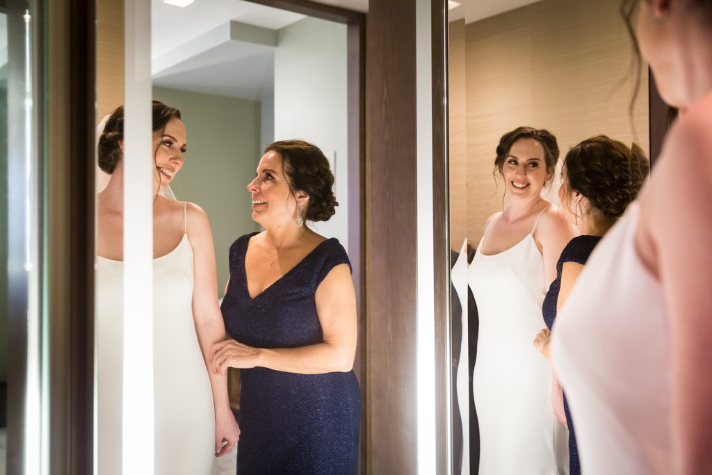 Mother and bride reflected in mirror