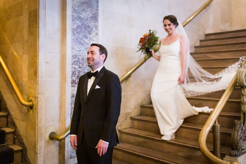 Bride and groom first look in Grand Central Terminal at a Water Club wedding