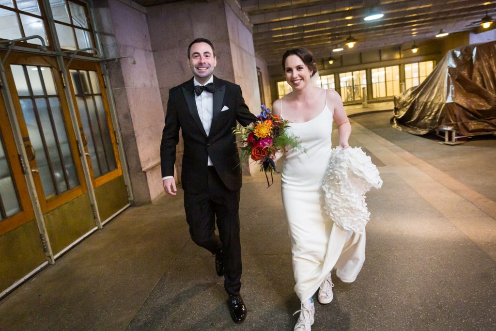 Bride and groom walking into Grand Central Terminal at a Water Club wedding