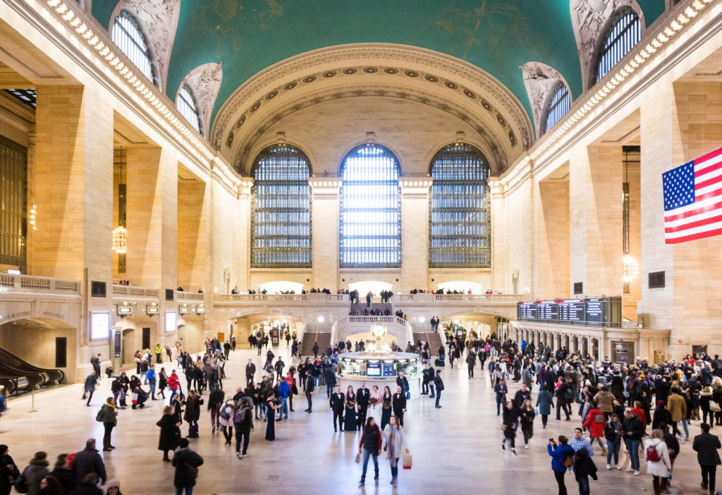 Grand Central Terminal main concourse with crowds and bridal party