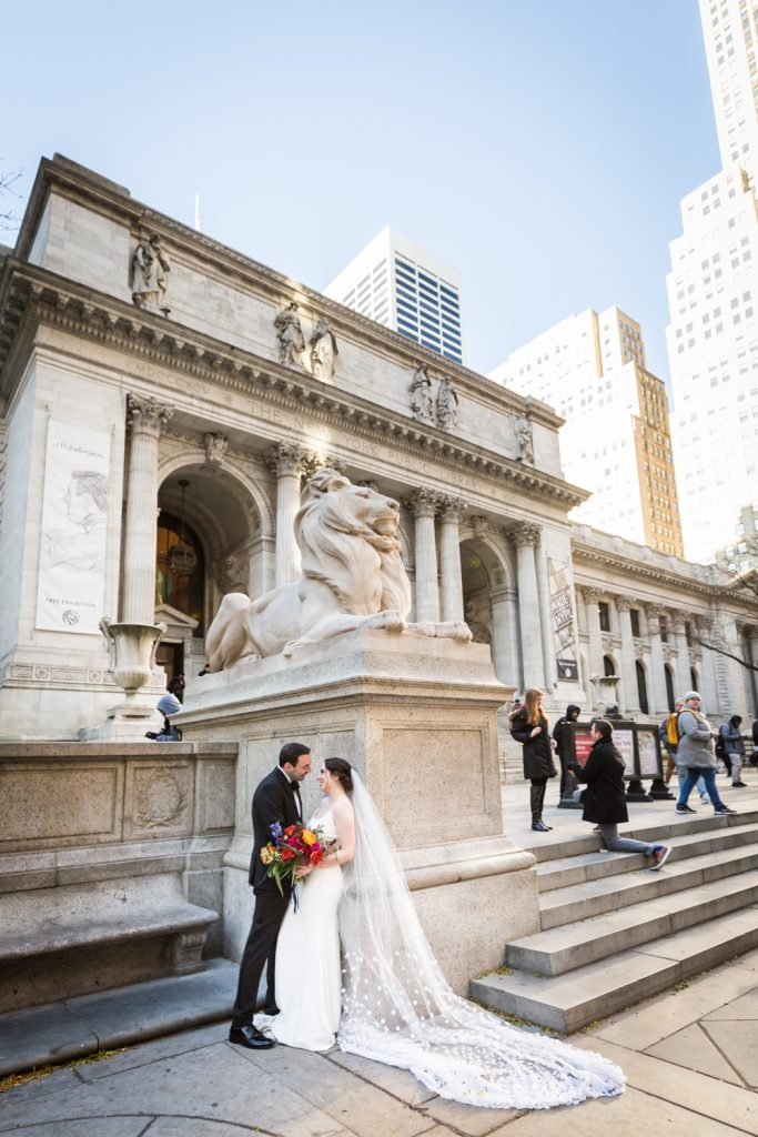 Bride and groom in front of New York Public Library at a Water Club wedding