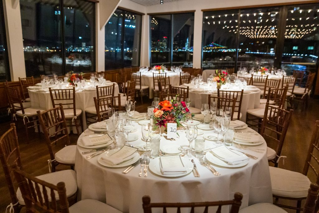 Tables set for wedding reception at a Water Club wedding