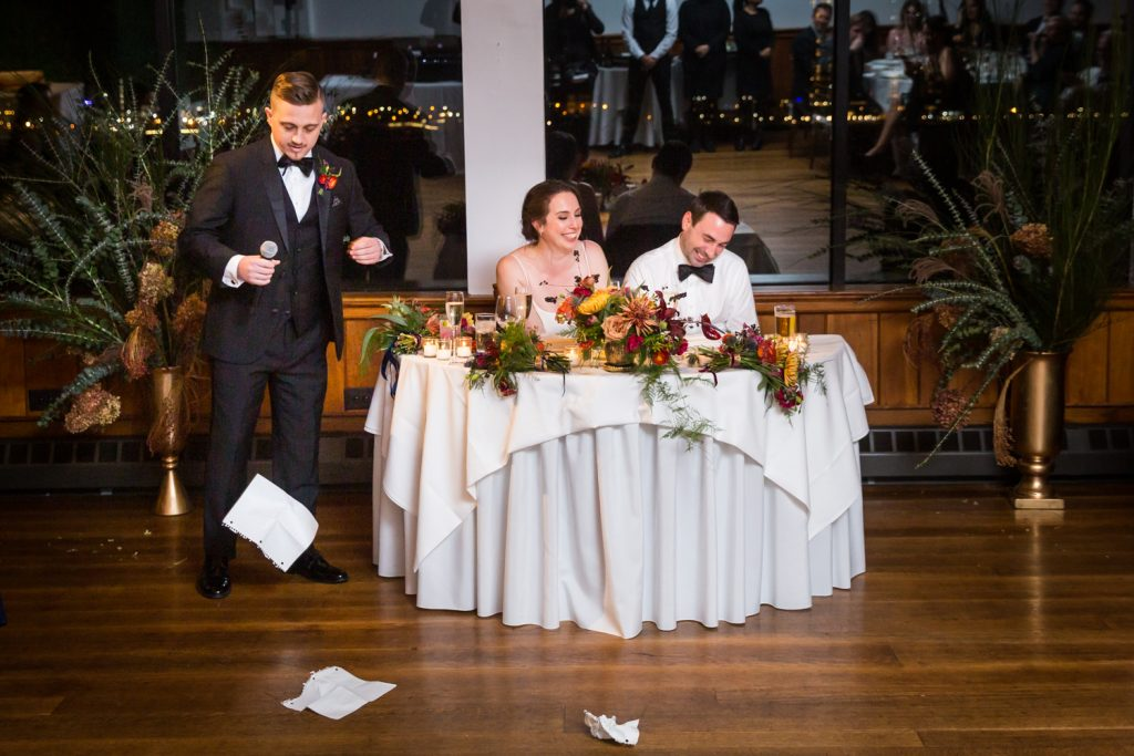 Best man making speech with falling papers at a Water Club wedding