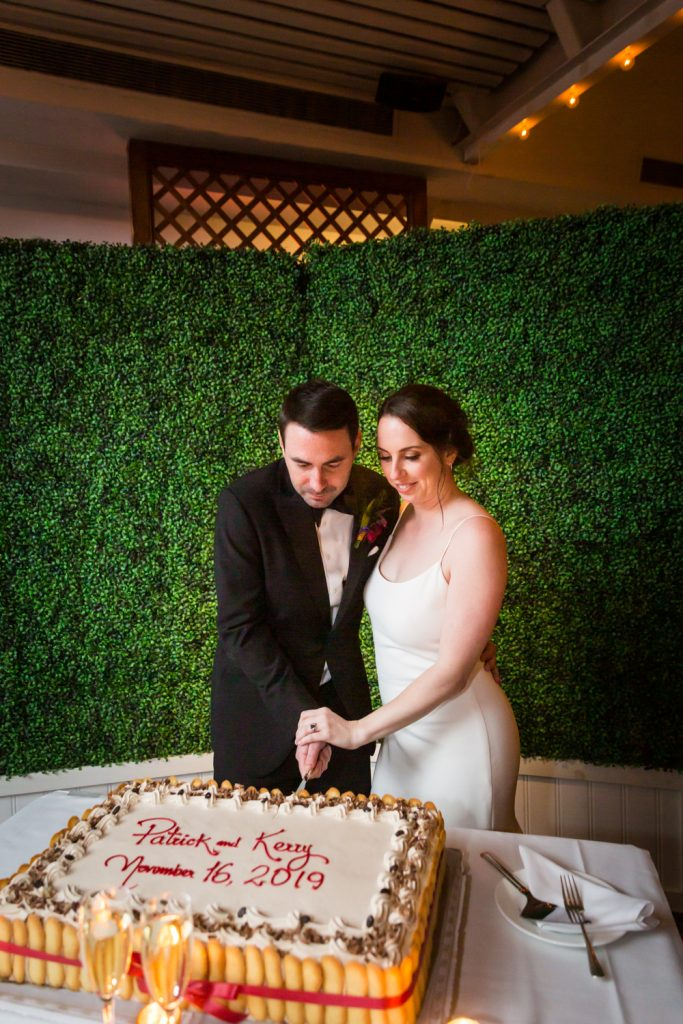 Bride and groom cutting cake at a Water Club wedding