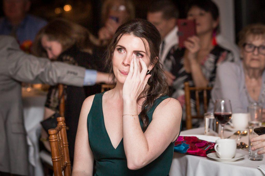 Bridesmaid wiping away tear at a Water Club wedding