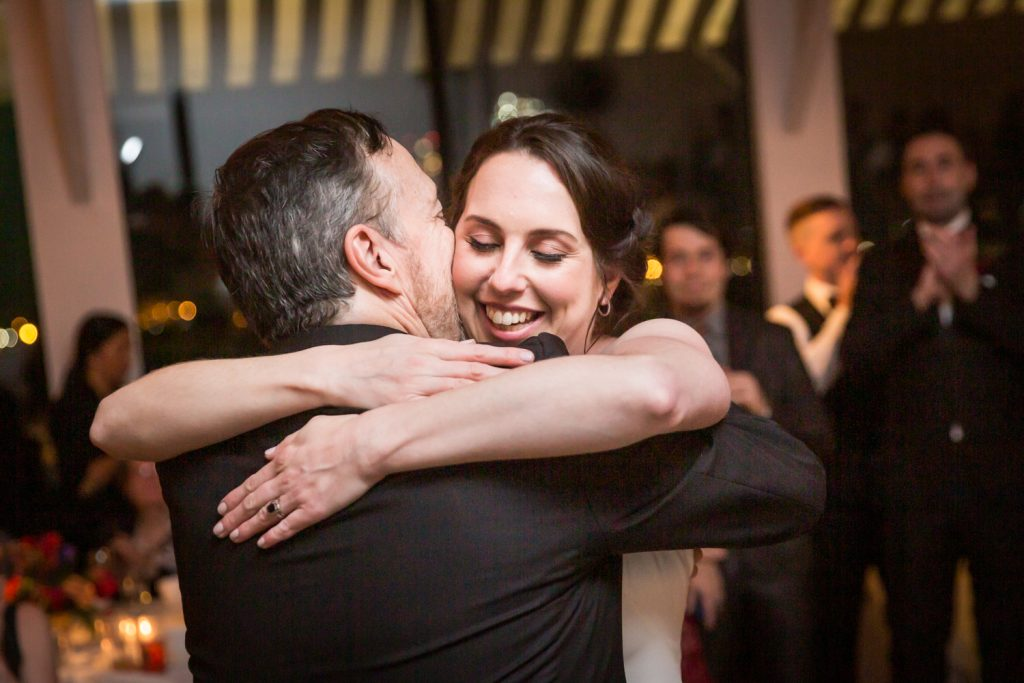Bride hugging father at a Water Club wedding
