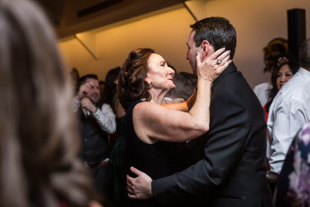 Mother holding groom's face at a Water Club wedding