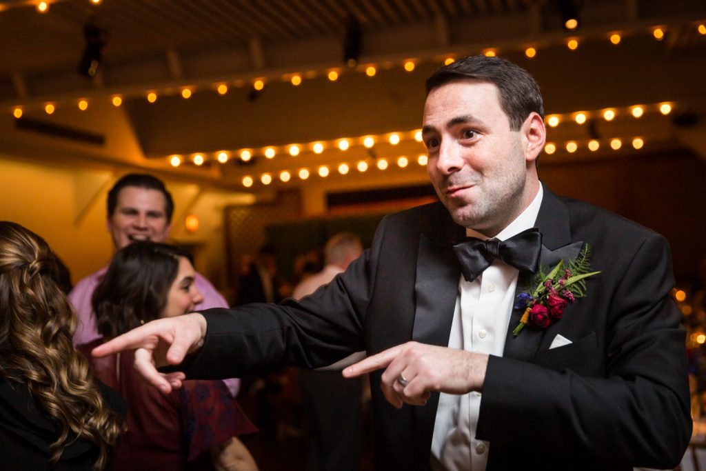 Groom pointing on the dance floor at a Water Club wedding