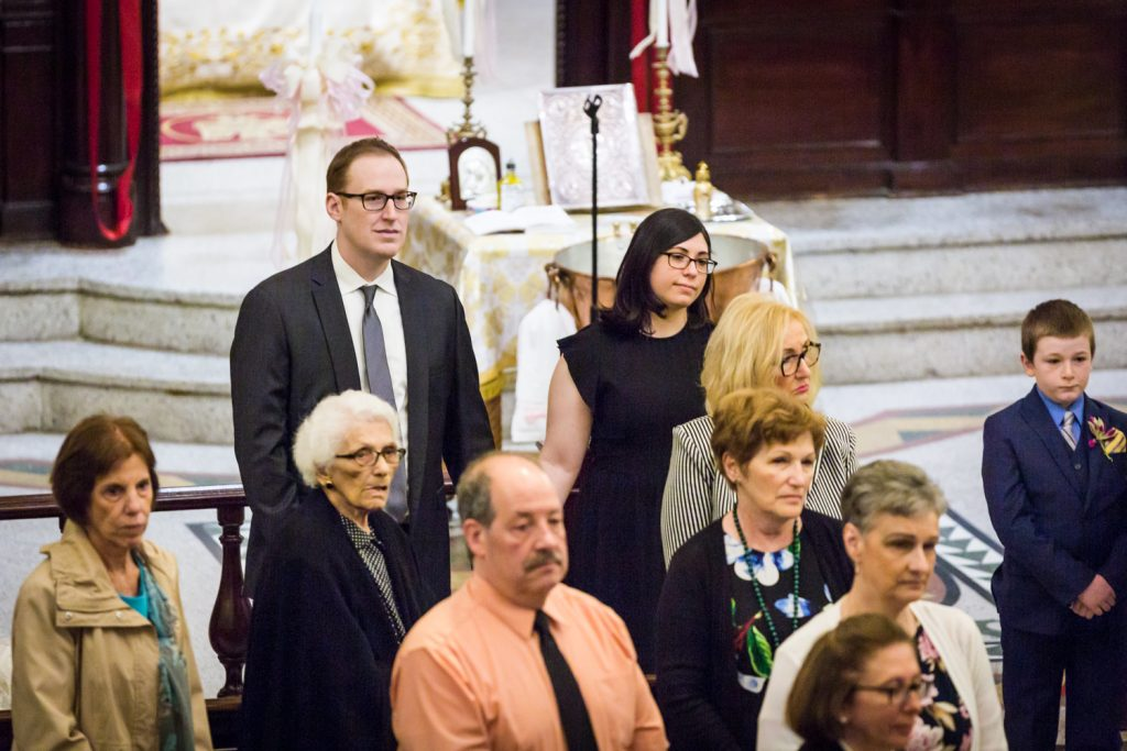 Greek orthodox baptism photos of guests watching ceremony