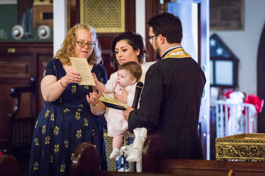 Greek orthodox baptism photos of godparents reading to baby