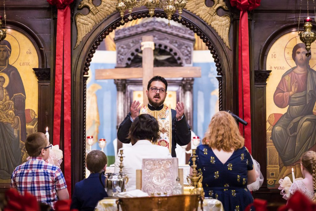 Greek orthodox baptism photos of priest during ceremony