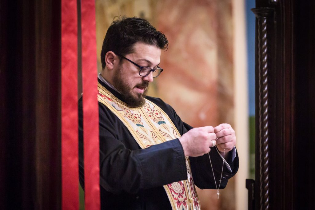 Greek orthodox baptism photos of priest with cross necklace