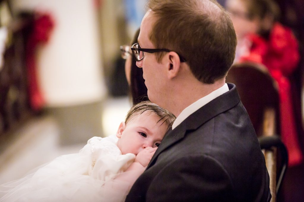 Greek orthodox baptism photos of baby held by father