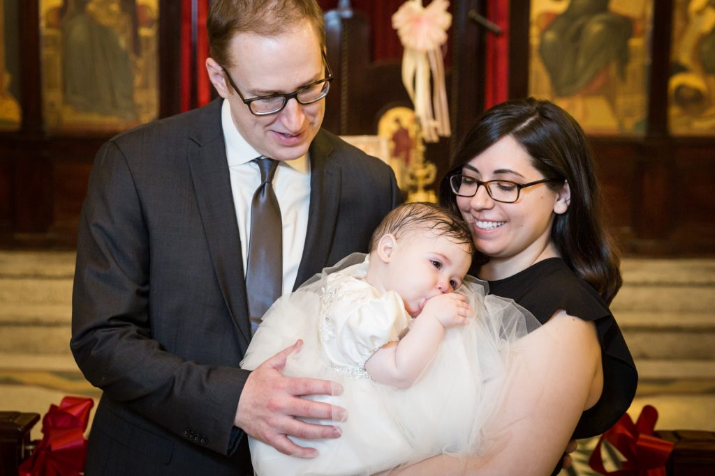 Family portrait of parents with newly baptized baby