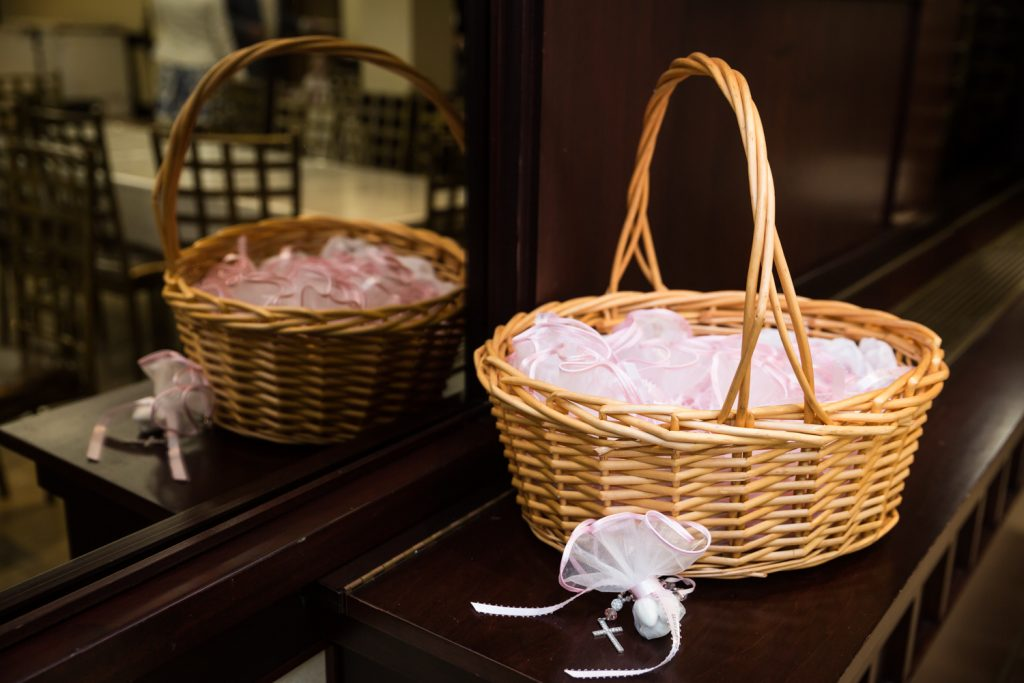 Basket with guest favors of sugared almonds at a Greek baptism