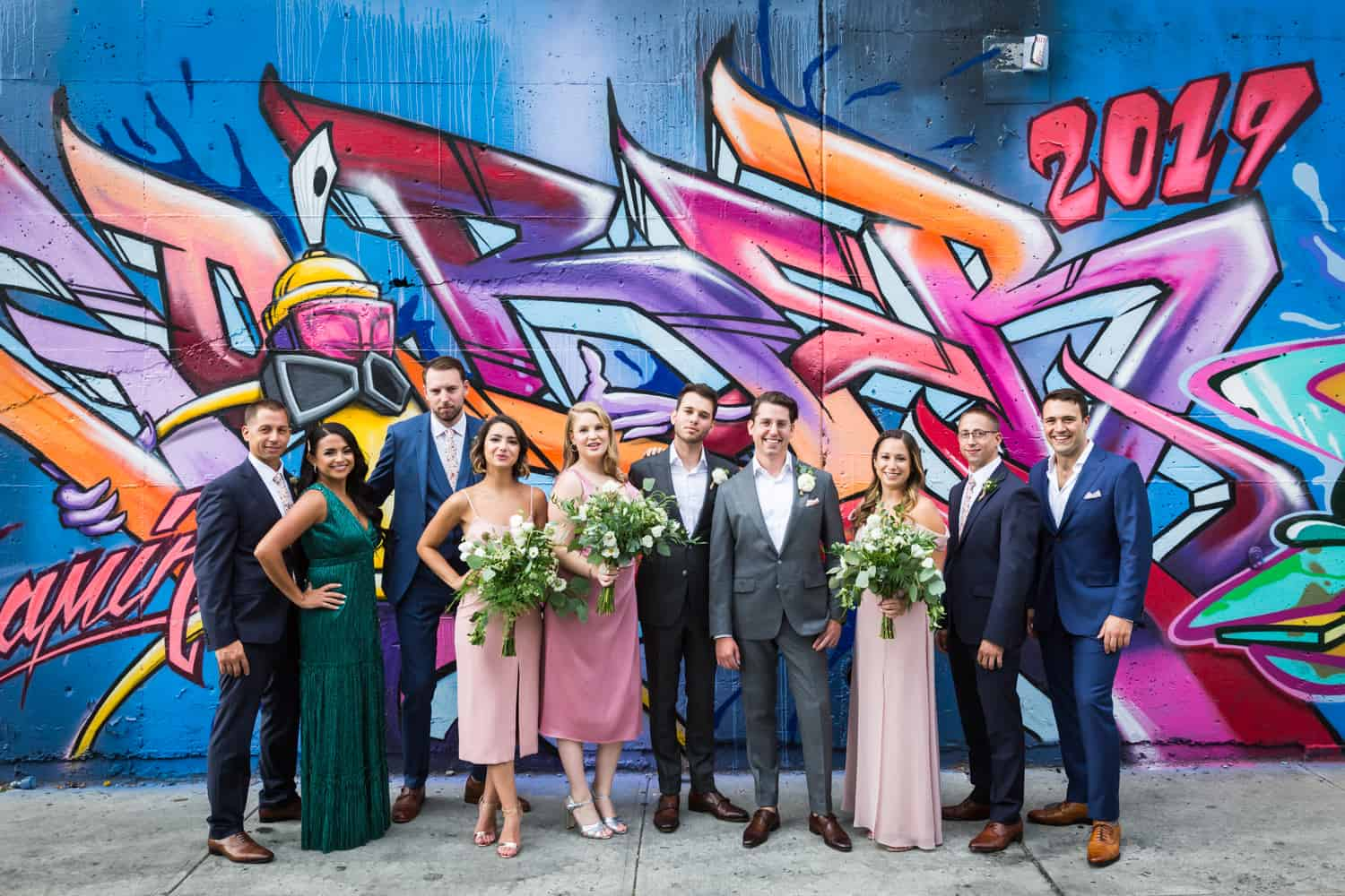 Bridal party in front of colorful mural in Greenpoint, Brooklyn