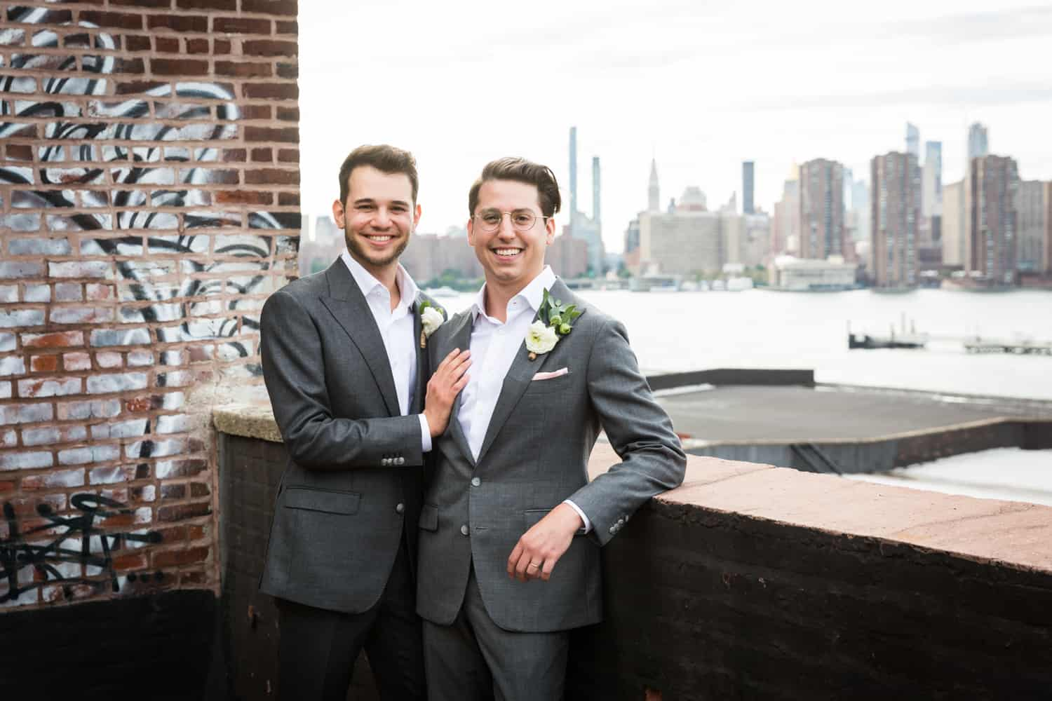 Greenpoint Loft wedding photos of two grooms on the roof with NYC skyline in background