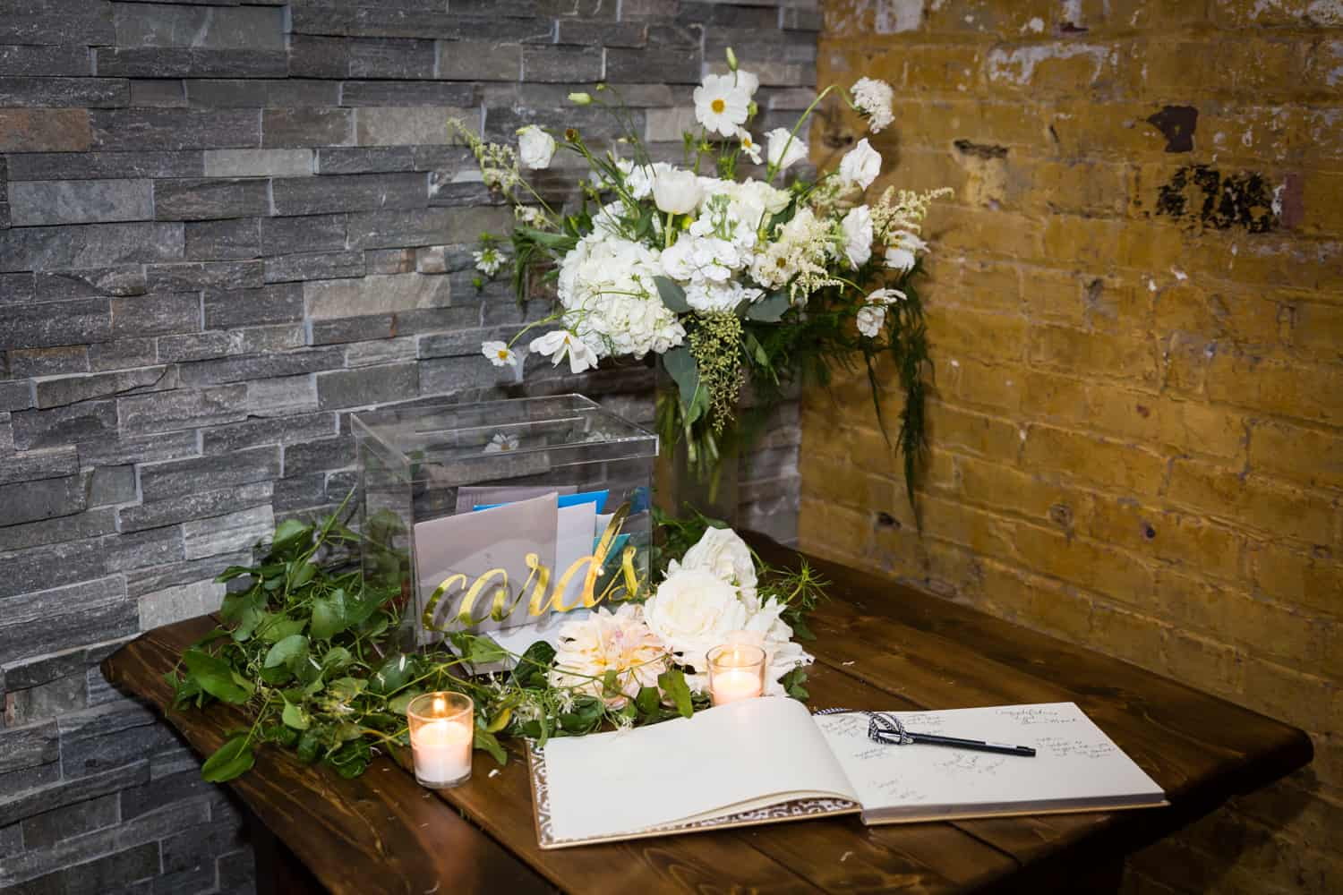 Table with bouquets of flowers and guest book