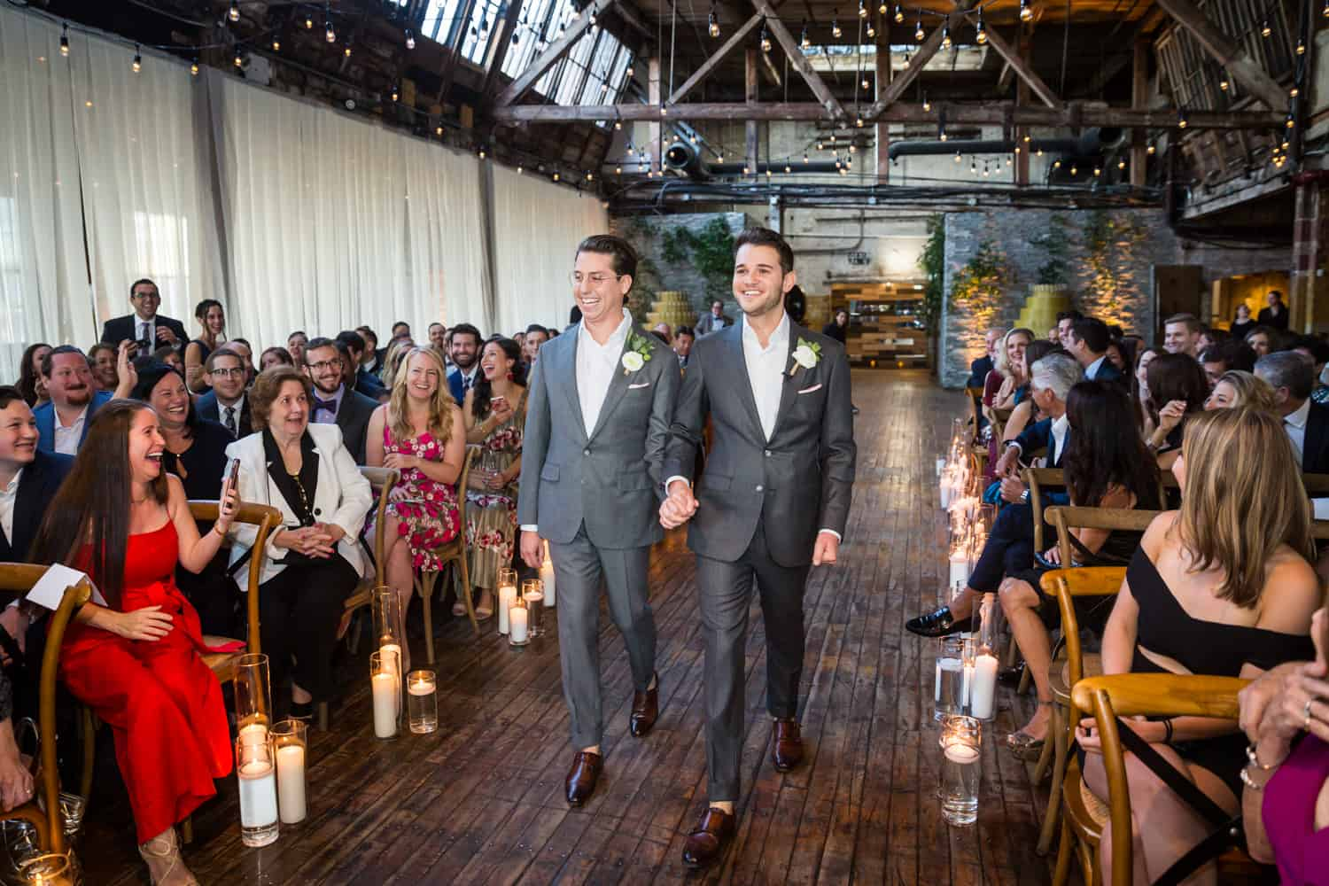 Greenpoint Loft wedding photos of two grooms walking down aisle