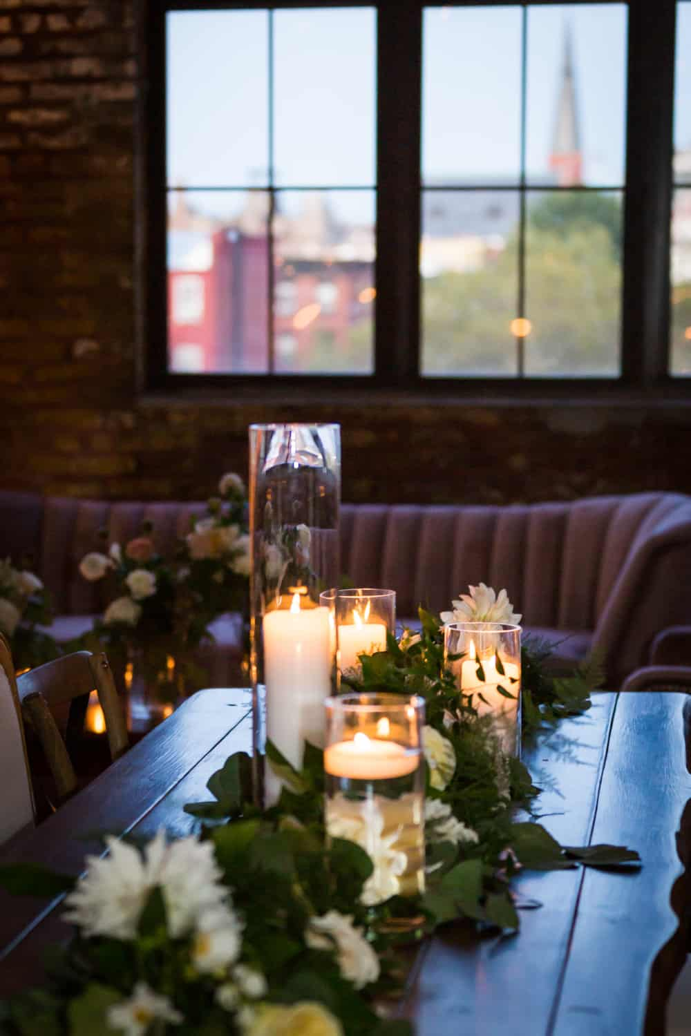 Table with lit candles and flowers