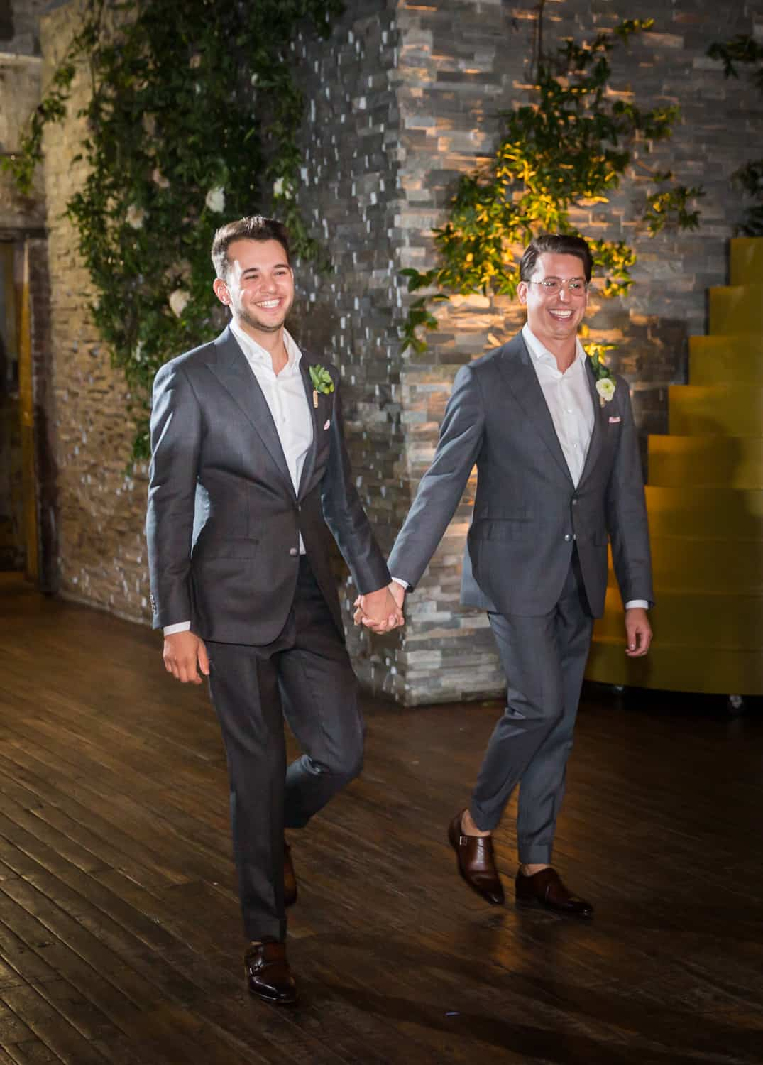 Greenpoint Loft wedding photos of two grooms entering reception