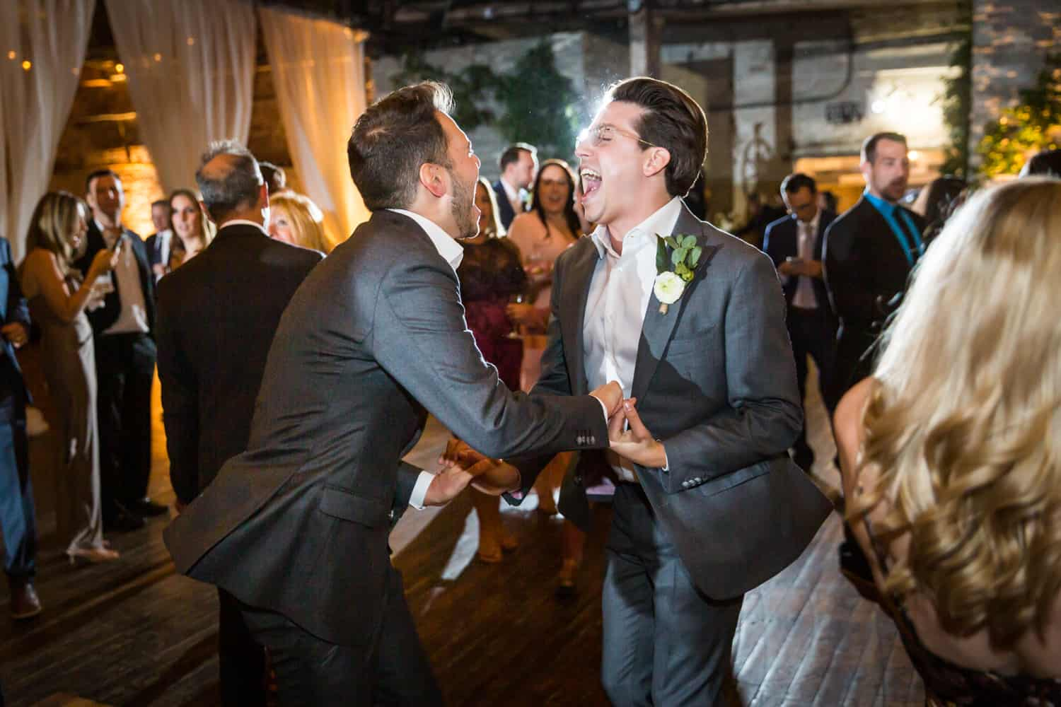 Greenpoint Loft wedding photos of two grooms dancing