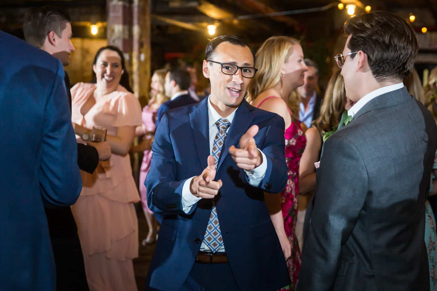 Greenpoint Loft wedding photos of guest dancing and pointing to camera