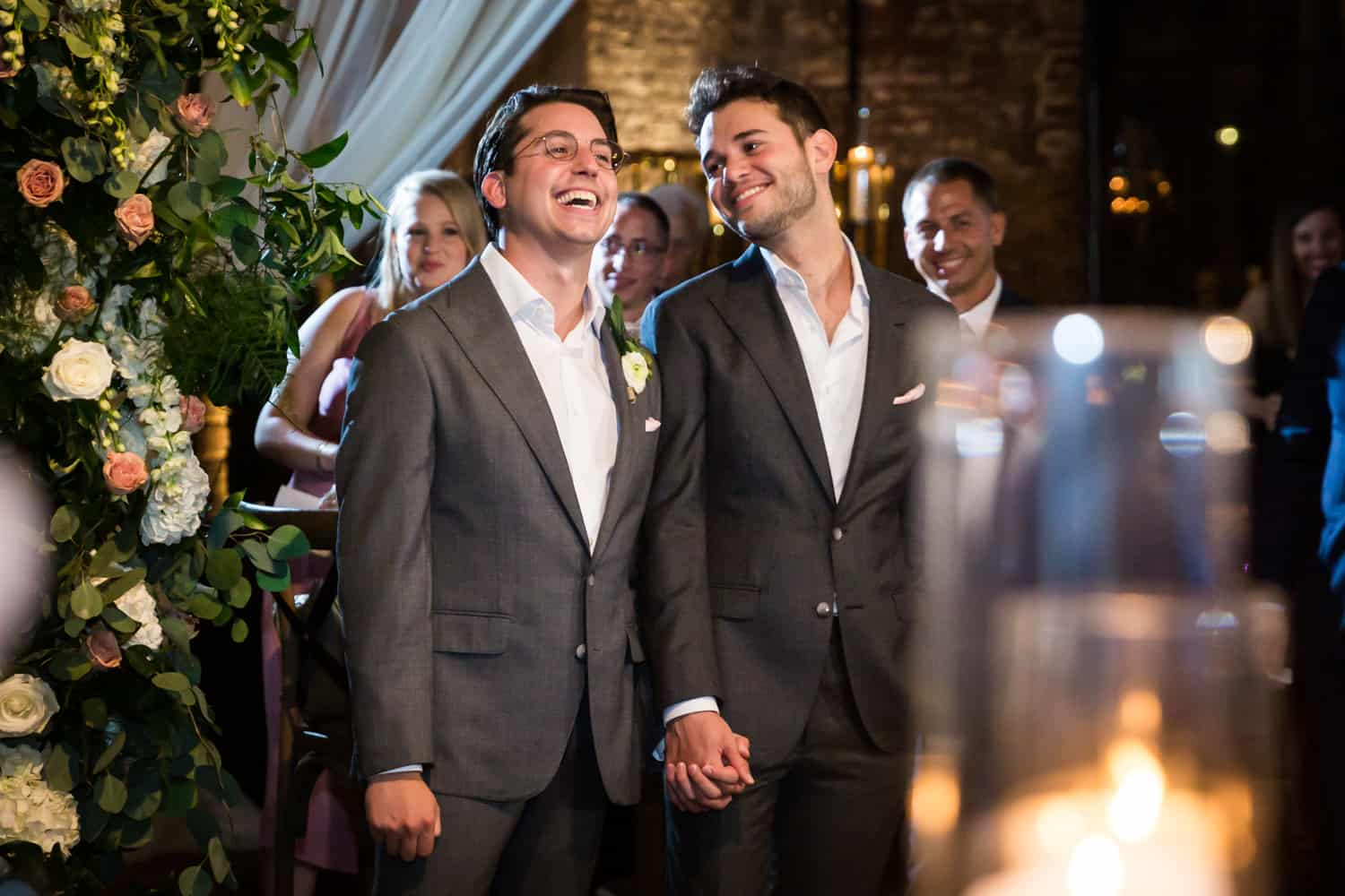 Greenpoint Loft wedding photos of two grooms listening to speeches