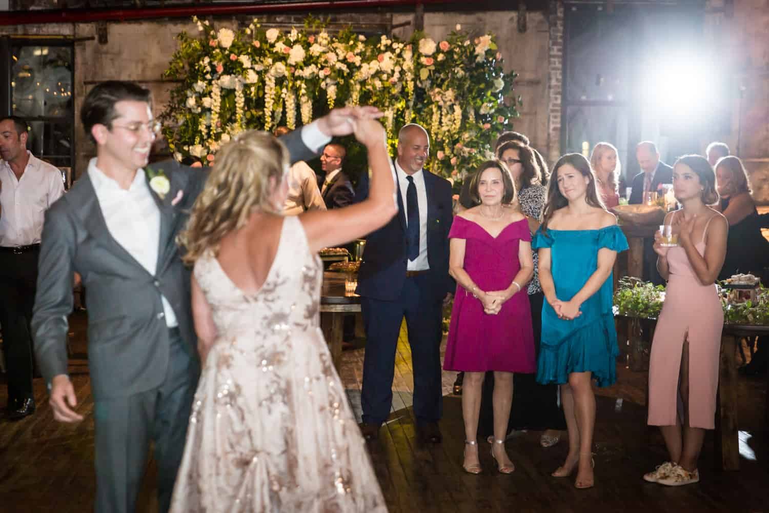 Greenpoint Loft wedding photos of guests watching groom dancing with mother