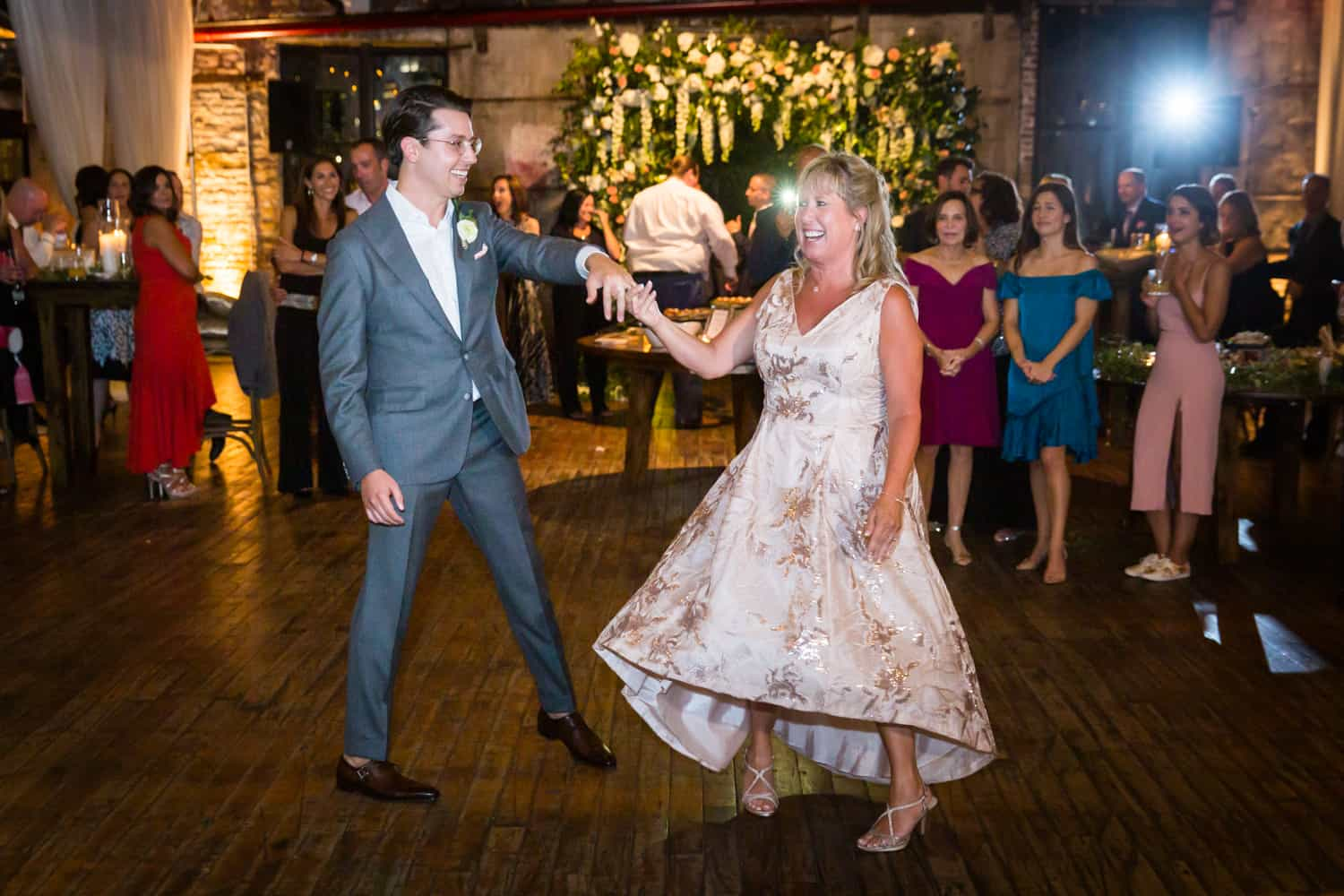 Greenpoint Loft wedding photos of groom dancing with mother